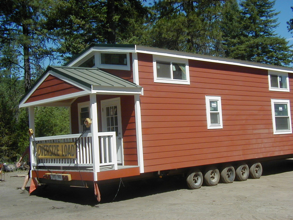 Lake view cabin with hardie plank tiny portable cedar cabins for Small portable homes